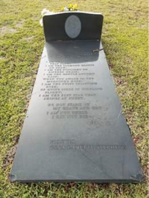 Figure 5 Headstone and large poetic text over plot